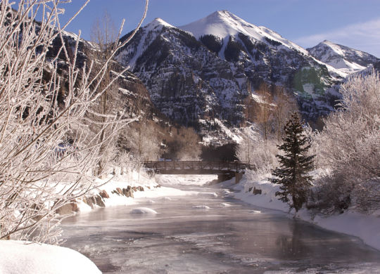 Snowy river in the mountains, very cold day